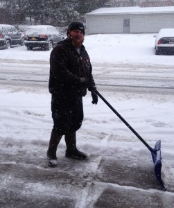 Sam from G.A. Bove Fuels shoveling snow