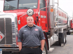 G.A. Bove Fuels employee in front of fuel truck